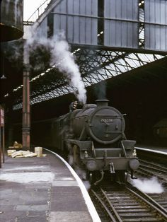 The fireman of LMS Class 5 4-6-0 45279 tends to his coal at Manchester Exchange prior to leaving on the 15.10 express to Bangor. 22nd June 1966 (Bill Wright)