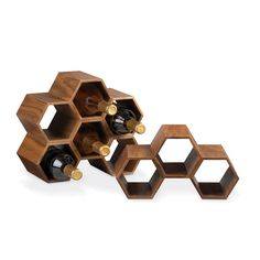 This modular counter top wine storage unit is made of walnut veneer and, like a beehive, can pack a multitude of storage nooks into a small space. - Dwell | At Home in the Modern World: Modern Design & Architecture