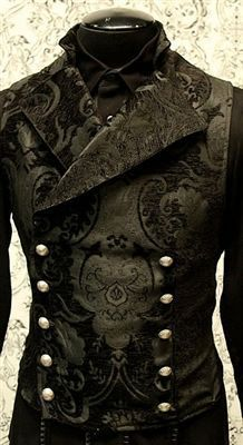 An elegant double breasted vest for formal occasions. A fitted vest made in rich black tapestry fabric with a stand up to collar and wide sweeping lapels. Fastens on the inside with a sturdy button and buttons on the outside with five engraved metal buttons. The vest back and inside lining is made from rich black satin.