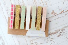 Cute idea to paint clothes pins gold, mint, and coral to hang pictures for a wedding!