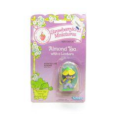 Almond Tea with a Lantern Miniature Figurine on backcard