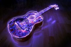 http://favim.com/orig/201107/23/color-guitar-lights-music-photography-Favim.com-112654.jpg