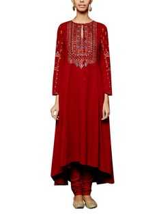 A striking red suit by Anita Dongre showcasing subtle pretty detailing. The malkha cotton tunic features elegant dori and tikki embroidery. It has been teamed with a cambric cotton churidaar. Style this suit with silver mojris, silver earrings and a ring to look ravishing at a sangeet or mehendi function. #indiandesigners #anitedongre #salwars #red