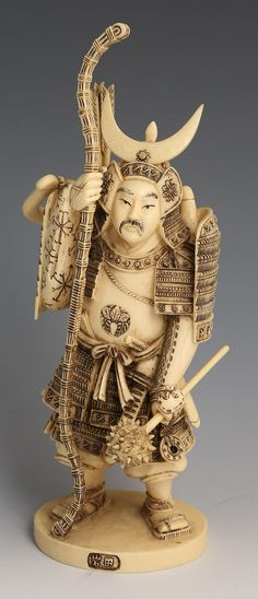 "EARLY 20TH C JAPANESE IVORY WARRIOR FIGURE SIGNED Japanese carved ivory figure of a warrior with staff, mace, and bow and arrows. Japanese character on front of base, signature to bottom. Comes with wooden base. Bow and mace not attached to figure. Early 20th century. From private Florida estate. Weight: 335.2g Size: 7.5"" plus base"