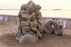 I found this sand castle of Medusa's head interesting and very appropriate, considering that her head was placed on plants in the sand (face down) by Perseus, which absorbs her powers.
