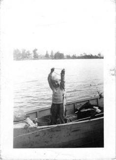 Black and White Vintage Snapshot Photograph Boy Fishing Catch Boat Lake 1940's