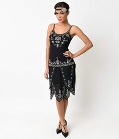 This is a divine flapper style dress for your consideration! It has a jet black color with generous silver deco style beading, an intriguing blue ribbon detail along the dropped waist and a fabulous sectional carwash hem that sways as you move. This dress Flapper Style Dresses, Great Gatsby Dresses, Beaded Flapper Dress, 1920s Dress, Retro Dress, Fancy Dress, 40s Outfits, Vintage Outfits, Vintage Clothing