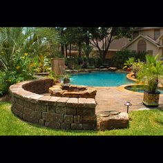 fire pit with pool. Surrounding wall to black sparks