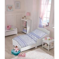 With crisp, white wainscoting detail, KidKraft Nantucket Toddler Cot model# 86621 captures the freshness and simplicity of vacations by the beach. The Nantucket Toddler Cot is sized just-right for a toddler. With elegant, smooth lines the Nantucket Toddler Cot is a serene and perfect place for sweet dreams.<br><br>KidKraft Nantucket Toddler Cot 86621 features:<br><br> * Mattress is same size as crib mattresses <br>* Low to the ground <br>* Wainscoting wood...