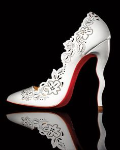 "Christian Louboutin laser-cut patent leather pump. 4.8"" covered squiggle heel…"