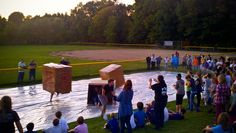 A team relay game where students run down a slippery tarp while covered in a moving box. Game is really wet, gets messy, and usually turns into chaos ...it's perfect!