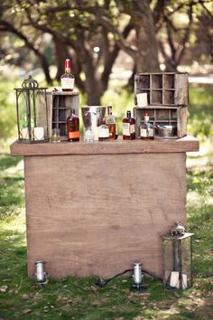 Whiskey Bar!!   Love the old drink crates, ice bucket, stack of glasses and several offerings of whisky/bourbon