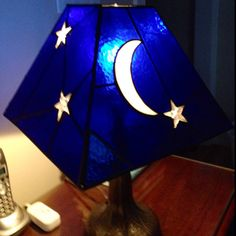Moon and Stars stained glass lamp on my bedside table