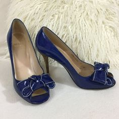 """Stuart Weitzman Royal  blue patent leather heels Stuart Weitzman Royal blue patent leather heels with large bow and white contrast stitching. 4"""" wood look heel. These are in great condition almost never worn. Size 7M. Insoles measure 9 1/2"""" long for reference. Stuart Weitzman Shoes Heels"""