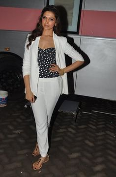 Padukone in a chic white pantsuit for a promo tour, August 2013.