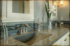 concrete counter; glass tile backsplash