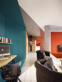 This modern apartment uses stylish blue and orange paint to transform the walls with optical illusions. PLASTERLINA recently completed the design of this colorf