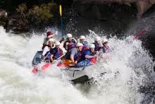 White water rafting West Virginia! Great memories of this, would like to do it again but not have a boat flip onto my head this time......