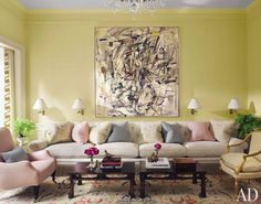 An untitled Joan Mitchell painting hangs above a custom-made sofa in the living room of a New York City townhouse decorated by Jeffrey Bilhuber. The tables are 17th-century Japanese.  ARCHITECT: Bilhuber & Associates DESIGNER: Peter Pennoyer Architects PHOTOGRAPHER: Pieter Estersohn