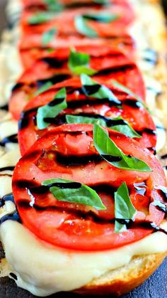 Toasted Caprese Garlic Bread ~ made with hints of garlic and topped with ripe tomatoes, fresh basil, and creamy mozzarella cheese!