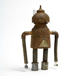 Robot made from found objects, by Shawn Murenbeeld. Love the whimsy that comes from the proportions of those arms!