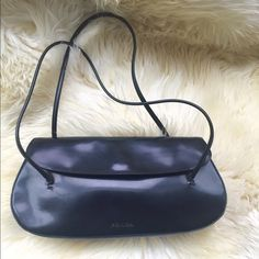 🛍 PRADA black structured leather shoulder bag. 💋FREE SHIPPING ON THIS ITEM 💋🛍❤️ Beautifully crafted structured leather bag. Purchased in Florence, this style is unique to the European market! Only used a few times, there is a very slight scratch on the flap that is only noticeable if you're looking very close. A pic of the authentication tag has been added. Price reflects condition. Make me an offer today! Prada Bags Shoulder Bags