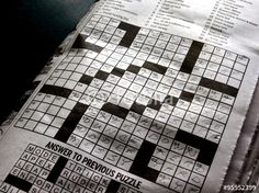 Solving the crossword puzzle in the newspaper.