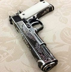 M1911 << Looks similar to Dean's pistol from Supernatural.