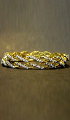#Bangles & #Bracelets - Stone Studded Bangles With Gold Finish Costs Rs. 1,012. #Jewellery. BUY it here: http://www.artisangilt.com/imitation-jewellery-fashion-jewelry/bangles-bracelets/stone-studded-bangles-with-gold-finish-81433.html?ref=pin