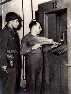 Nuremberg, Germany, A defendant in the Nuremberg Trials issued a broom to clean his cell, 1945-1946. World War Two