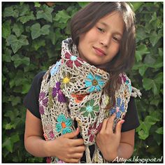Finally finished my Crochet Flower Shawl, made with Catona by Scheepjes .  I think it looks pretty good on me, but my little girl looks s...