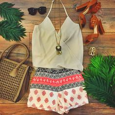 We love this summer #OOTD  Halter Tank Oyster ($19.99) Stamped Print Shorts Apricot ($24.99) both at #sophieandtrey Woven Handbag Mocha in store at #4thandocean and all online! // #fashion #printshorts #summer #inspo #boutique