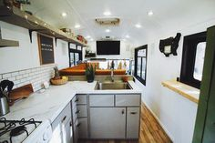 This custom diy skoolie bus conversion looks so modern! I love the living space, full kitchen, bathroom layout and storage design. It looks like living in a tiny house! Great adventure vehicle and blog with ideas and hacks about planning your camper adventure! #vanlife Modern Tiny House, Tiny House Living, Tiny House Design, School Bus Tiny House, School Bus House, School School, Bus Remodel, Converted School Bus, Bus Interior