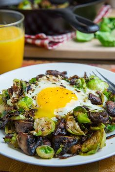 Brussels Sprout and Mushroom Hash Recipe : Brussels sprout and mushroom hash with fried eggs that makes for a tasty fall breakfast or brunch! Healthy Recipes, Great Recipes, Whole Food Recipes, Vegetarian Recipes, Cooking Recipes, Favorite Recipes, Healthy Dishes, Fall Recipes, Keto Recipes