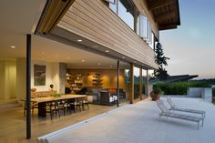 Wood to concrete threshold and indoor/outdoor space