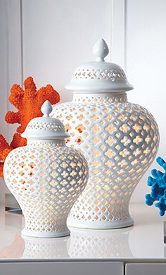 Mediterranean inspired porcelain covered lanterns in two sizes by Two's Company.