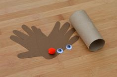 Toilet paper roll handprint Rudolph the Red Nosed Reindeer Kid Craft for Christmas