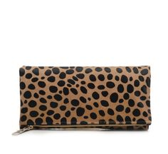 The perfect year round accent piece -  The foldover clutch by Los Angeles designer Clare Vivier.  Known for her chic, sporty designs and eco friendly materials, this hair calf leather clutch is timele...