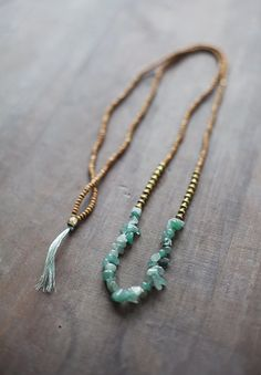 Green Aventurine Gemstone Necklace made of brown wooden beads (size 2x3mm) (0.07 x 0.1) free-form green aventurine gemstone beads metal beads (colour - antique gold ) Necklace length: 100cm from end to end (39.3) or 78cm from end to end (30.7) NOTICE: It may take me up to 10 days to get the item shipped out