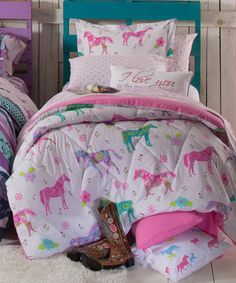 Little Girls Pony Bedding Little Girls Pony Bedding: Tuck your little cowgirl into this bright and cheerful bedding and she's sure to drift off to sleep with a smile on her face, ready for sweet dreams. This new bed-in-a-bag is a celebration of colorful ponies sprinkled all over with pretty flower blossoms. Matching accessories sold separately.