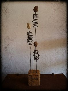 Driftwood base- could use stones, shells & glass on wire