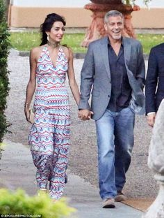 Perfect fit: Falling from Amal's hips down into a long, flowing skirt, the red, white and ...
