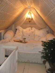 From Rebecca Ersfeld's attic space.  What a lovely guest room/ Mommy hideout.