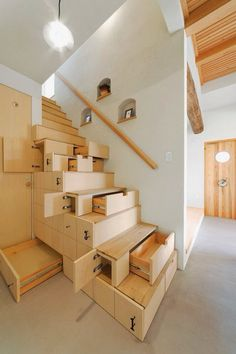 This crafty use of space under the stairs to create storage space in the form of long drawers of a verity of sizes, is a showcase of custom cabinetry and millwork. It makes me wonder how I would appreciate the same set of stairs through my 8 year old eyes? What an intriguing and imaginative way to use space that is generally a void.