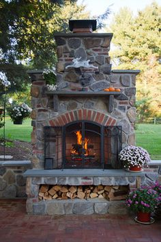 Backyard Retreats....great outdoor fireplace