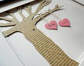"""Lyric Tree - 3D tree & hearts in an 11""""x14"""" black frame on an 8""""x10"""" double mat board. Tree is hand cut from your choice of wording printed on white cardstock in black 9pt. Bookman OS (song lyrics from a special occasion, wedding vows, poetry, birth announcement, etc.). Two hearts are printed w/the initials of you & your other half, etc. w/matching butcher twine in your choice of colours. Can be created in memoriam to a lost loved one, for an anniversary, birth of a child, etc."""