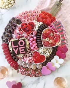 This stunning board is what every Valentine's Day party needs. Mix and match your favorite gummy candies, chocolate covered pretzels and sprinkled, frosted cookies! Charcuterie Recipes, Charcuterie And Cheese Board, Valentine Desserts, Valentines Day Treats, Valentine Food Ideas, Kids Valentines, Party Food Platters, Crudite, Snacks Saludables