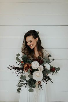 Large ivory and sage green wedding bouquet perfect for a winter wedding | Image by Peyton Rainey Photography and Chelsea Denise Photography