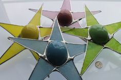 Big Egg Star- 9 inch Stained glass star with 2 3/4 inch ceramic egg center.  kurtknudsen.etsy.com