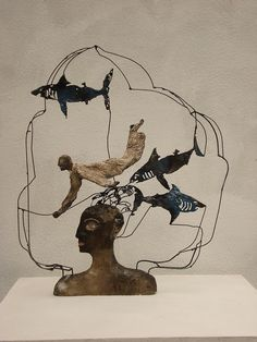 Make headover and man with clay wire wrap fish and put together (: idea!